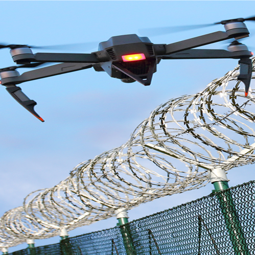 Drone over wire fence