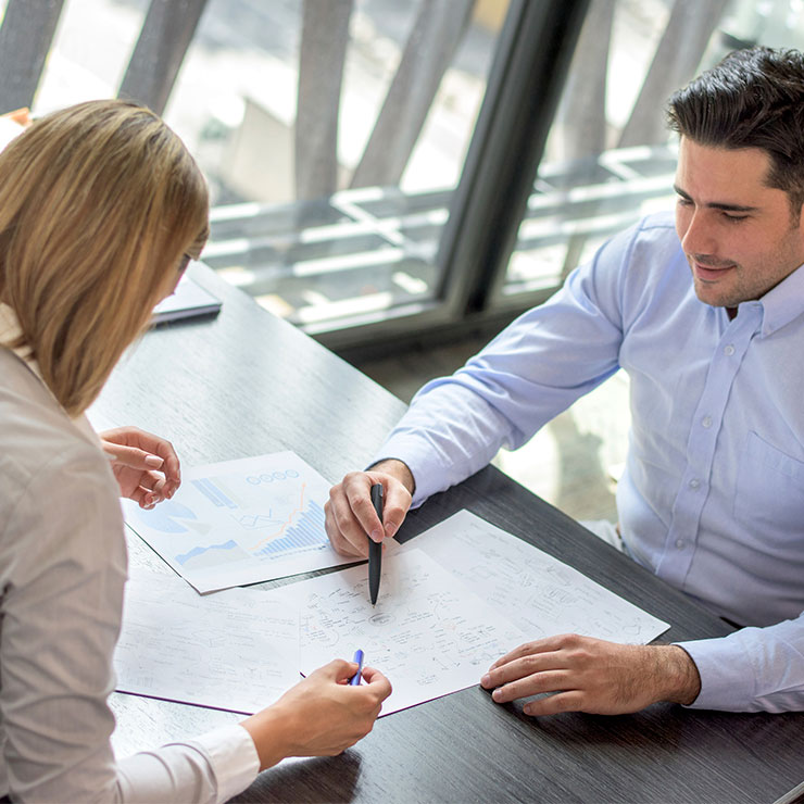 Two people having a meeting over a table