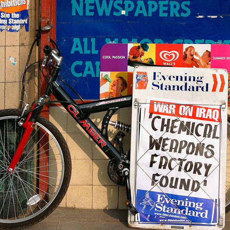 Newspaper closeup outside a corner shop