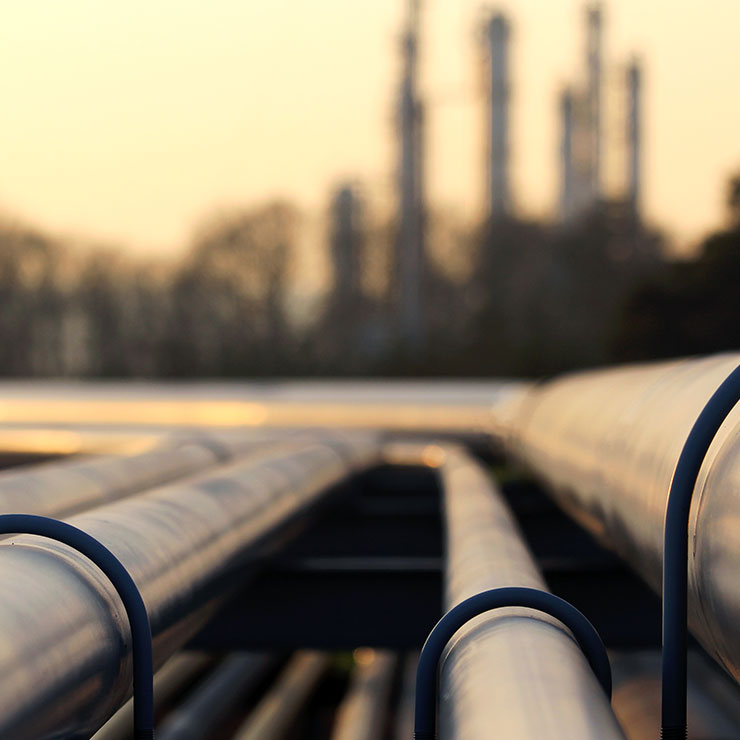 Large industrial pipes leading to the water