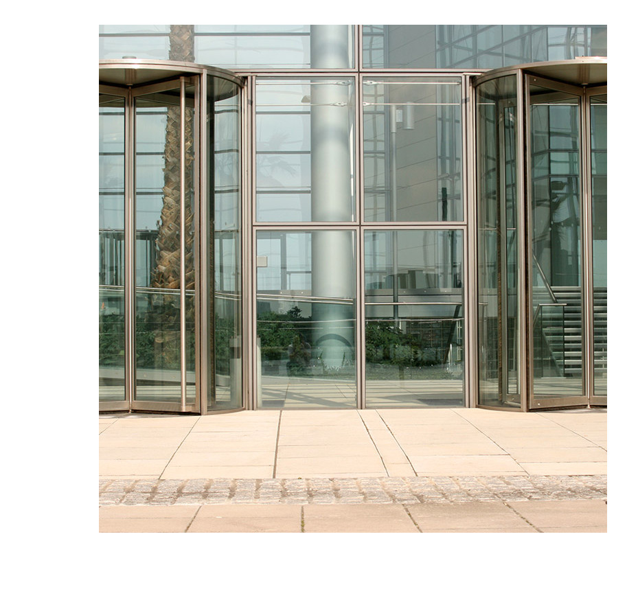 Glass turnstile entry point to a large building