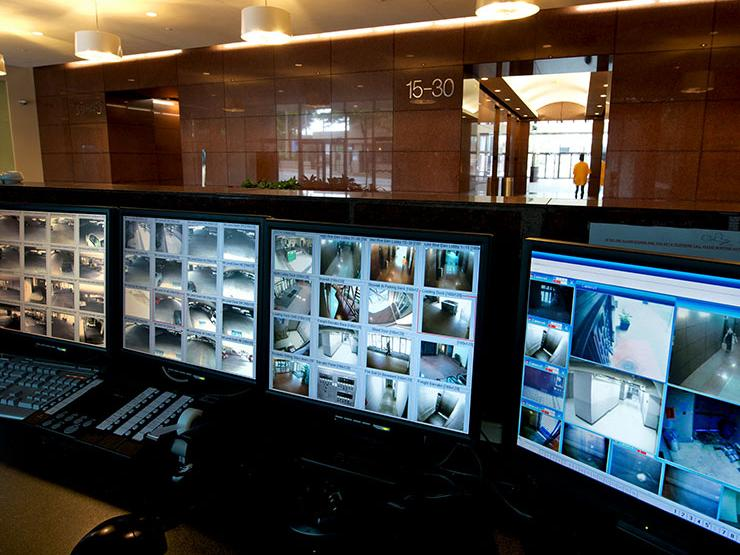 Control room with lots of computer screens