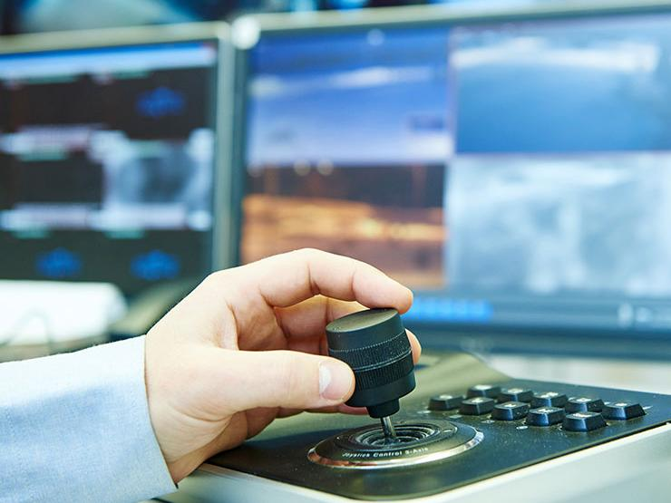 Person using a motion tracking joystick