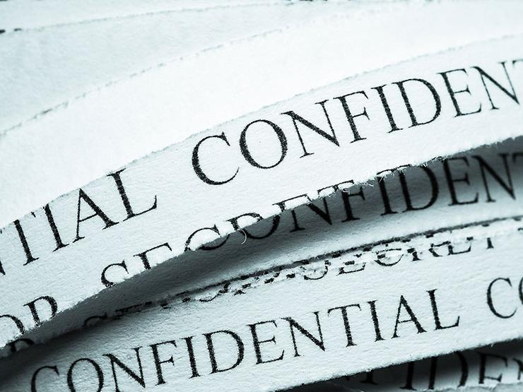 Shredded documents with confidential written on them