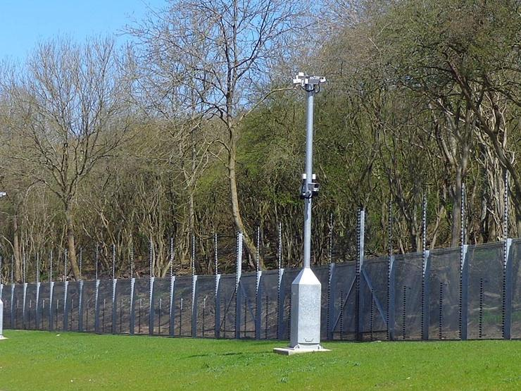 Security pole with camera surveying a property