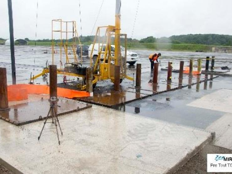 Surface mount bollards with tethered anchors